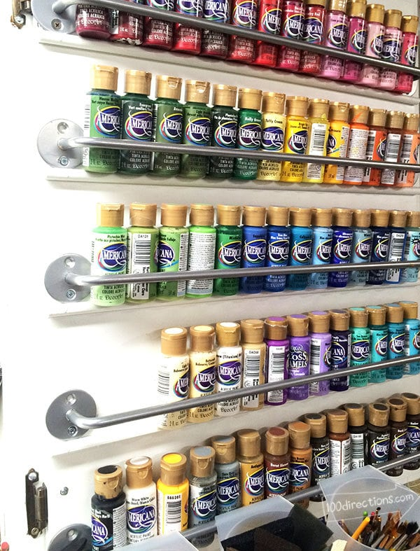 Organize craft paint on a cabinet door - 100 Directions