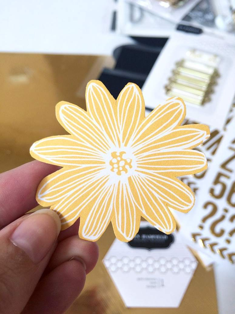 Cut out individual flowers from the patterned papers