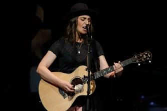 Sara Bareillis playing guitar