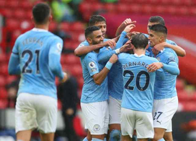 SHEFFIELD, ENGLAND - OCTOBER 31: Kyle Walker of Manchester City celebrates with teammates after scoring his team's first goal during the Premier League match between Sheffield United and Manchester City at Bramall Lane on October 31, 2020 in Sheffield, England. Sporting stadiums around the UK remain under strict restrictions due to the Coronavirus Pandemic as Government social distancing laws prohibit fans inside venues resulting in games being played behind closed doors. (Photo by Catherine Ivill/Getty Images)