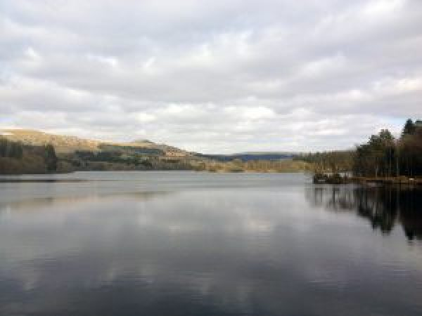 View across Burrator Reservoir on a cloudy day, with reflections of clouds on the water. Copyright Stephanie Boon, 2018. All Rights Reserved.