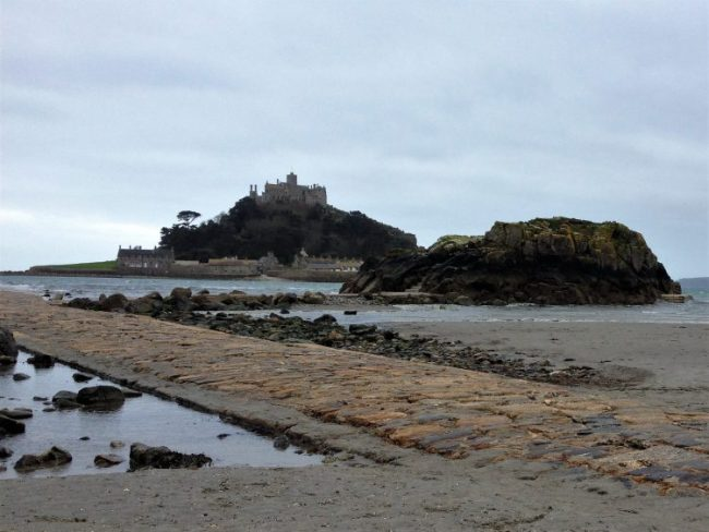 View of St Michael's Mount from the beach. St Michael's Way hike, Cornwall, UK.