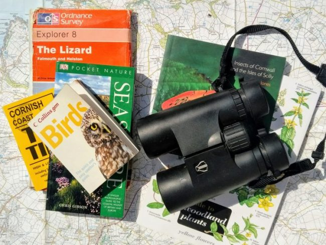 Field guides and binoculars on an open OS Map, ready to make a nature journal. Copyright Stephanie Boon, 2018. All Rights Reserved.