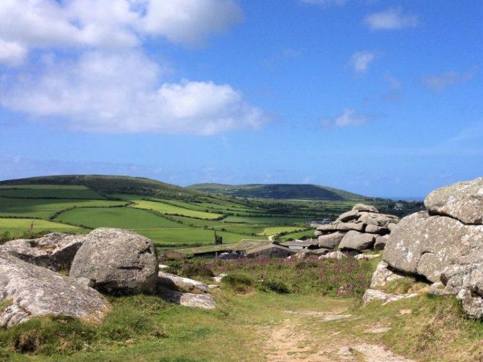 Granite tors on top of Trencrom Hill, St Michael's Way hike Cornwall, UK.