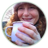 Portrait of Stephanie Boon drinking from an enamel mug.