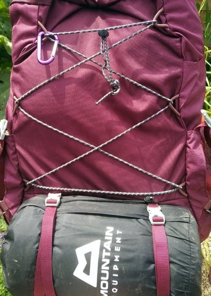 Elasticated cord laced to the backpack above the sleeping mat