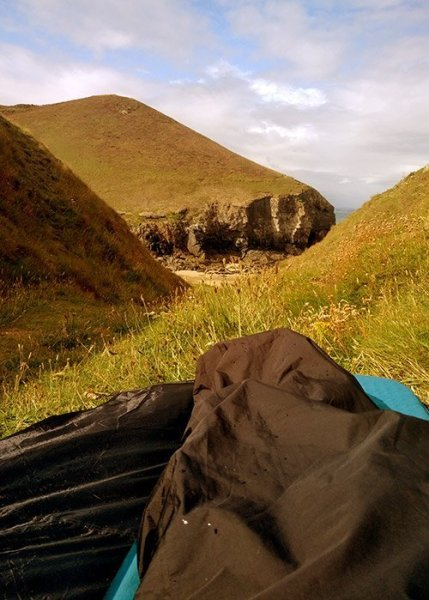 Featured Image: Get Ready For Your First Bivvy, 8 Ways To Stay Safe Overnight (image: view from a bivvy bag out over cliffs of north Cornwall)