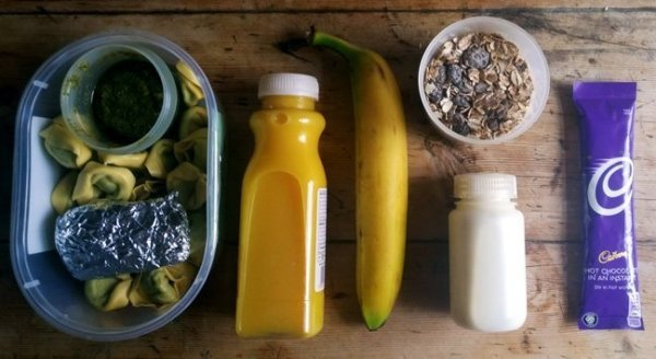 Simple camping food, including pasta, orange juice, mueseli, milk, hot chocolate sachet