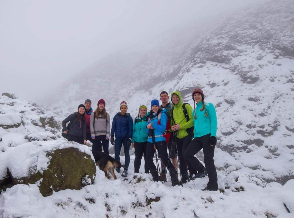 Group of hikers in the snowy mountains