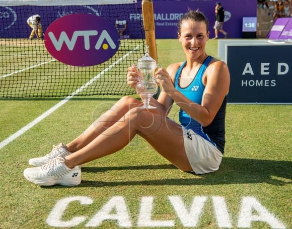 German tennis player Tatjana Maria celebrates her victory after beating Anastasija Sevastova of Latvia in the final of the Mallorca Open WTA tennis tournament at Santa Ponsa Tennis club in Calvia, Balearic Islands, Spain, 24 June 2018.  EPA-EFE/CATI CLADERA
