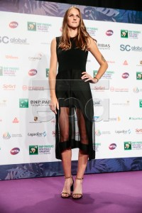 Karolina Pliskova of the Czech Republic poses for photographers as she arrives for the singles draw ceremony of the BNP Paribas WTA Finals 2018 held at the Marina Bay Sands Hotel in Singapore, 19 October 2018. The BNP Paribas WTA Finals 2018 will take place from 21-28 October 2018 at the Singapore Indoor Stadium.  EPA-EFE/WALLACE WOON
