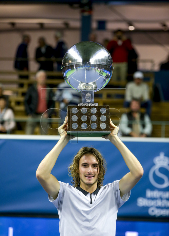 Greece's Stefanos Tsitsipas poses with his trophy after winning the ATP Stockholm Open tennis tournament men's single final against Latvia's Ernests Gulbis at the Royal Tennis Hall on October 21 2018, in Stockholm, Sweden.  EPA-EFE/Soren Andersson/TT  SWEDEN OUT