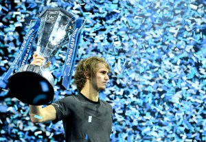 Germany's Alexander Zverev celebrates with his trophy after winning against Serbia's Novak Djokovic in their final match of the ATP World Tour Finals tennis tournament at the O2 Arena in London, Britain, 18 November 2018. EPA-EFE/WILL OLIVER