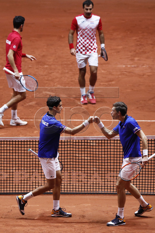 Pierre-Hugues Herbert (front L) and Nicolas Mahut (front R) of France react during their doubles match against Ivan Dodig (back R) and Mate Pavic (back L) of Croatia at the Davis Cup Final between France and Croatia at the Pierre Mauroy Stadium in Villeneuve-d'Ascq, near Lille, France, 24 November 2018.  EPA-EFE/YOAN VALAT