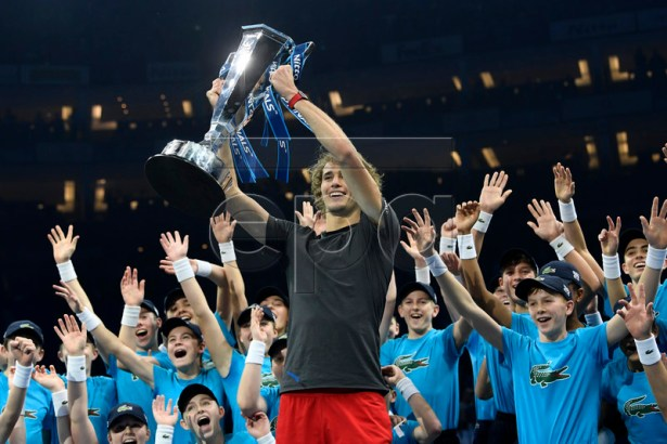 Germany's Alexander Zverev celebrates with his trophy surrounded by ball kids after beating Serbia's Novak Djokovic in their final match at the ATP World Tour Finals tennis tournament at the O2 Arena in London, Britain, 18 November 2018. EPA-EFE/WILL OLIVER