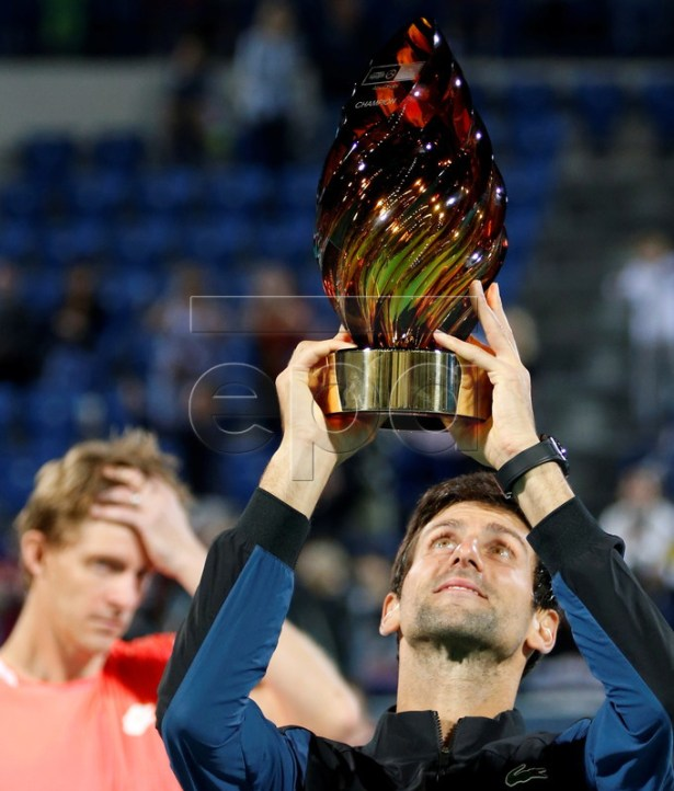Novak Djokovic (R) of Serbia lifts the trophy after winning the final match against Kevin Anderson (L) of South Africa at the Mubadala World Tennis Championship 2018 in Abu Dhabi, United Arab Emirates, 29 December 2018.  EPA-EFE/ALI HAIDER