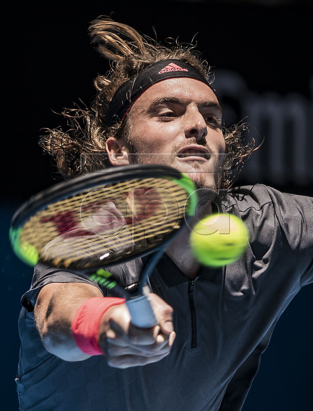 Stefanos Tsitsipas of Greece in action during the men's singles match between the USA and Greece on day 3 of the Hopman Cup tennis tournament at RAC Arena in Perth, Western Australia, Australia, 31 December 2018.  EPA-EFE/TONY MCDONOUGH AUSTRALIA AND NEW ZEALAND OUT  EDITORIAL USE ONLY