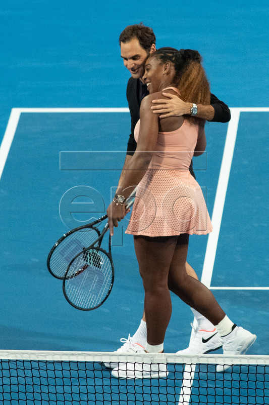 Roger Federer of Switzerland and Serena Williams of the USA leave the court after playing in the mixed doubles match between Roger Federer and Belinda Bencic of Switzerland and Frances Tiafoe and Serena Williams of the USA on day 4 of the Hopman Cup tennis tournament at RAC Arena in Perth, Western Australia, Australia, 01 January 2019.  EPA-EFE/RICHARD WAINWRIGHT AUSTRALIA  EPA-EFE/RICHARD WAINWRIGHT AUSTRALIA AND NEW ZEALAND OUT  EDITORIAL USE ONLY