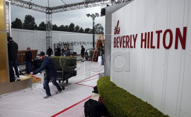 A worker wheels in plants on the carpet during set-up before the 76th annual Golden Globe Awards ceremony at the Beverly Hilton Hotel, in Beverly Hills, California, USA, 05 January 2019. EPA-EFE/MIKE NELSON