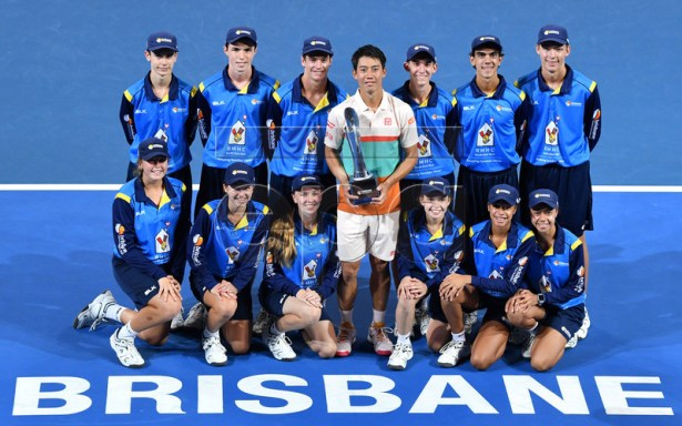 Kei Nishikori of Japan poses for a photo with the ball kids after winning against Daniil Medvedev of Russia during the Final of the Brisbane International tennis tournament at the Queensland Tennis Centre in Brisbane, Australia, 06 January 2019. EPA-EFE/DARREN ENGLAND EDITORIAL USE ONLY AUSTRALIA AND NEW ZEALAND OUT
