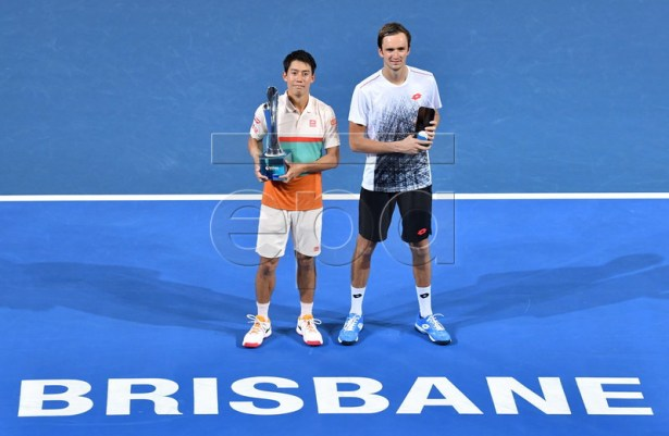 Brisbane International winner Kei Nishikori (left) of Japan and runner-up Daniil Medvedev (right) of Russia are seen with their trophies after the men's singles final at the Brisbane International tennis tournament in Brisbane, Australia, 06 January 2019. EPA-EFE/DARREN ENGLAND AUSTRALIA AND NEW ZEALAND OUT EDITORIAL USE ONLY