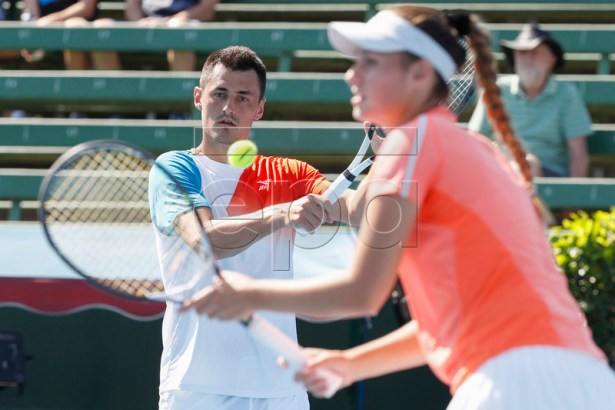 Bernard Tomic (L) and Sara Tomic (R) of Australia play mixed doubles against John Peers and Sally Peers of Australia during match four of Kooyong Classic tennis tournament at Kooyong Lawn Tennis Club in Melbourne, Australia, 08 January 2019.  EPA-EFE/DANIEL POCKETT AUSTRALIA AND NEW ZEALAND OUT