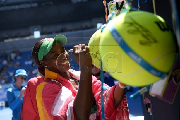 Sloane Stephens of the United States signs a ball for fans after winning the match against Taylor Townsend of the United States during their women's singles round one match of the Australian Open tennis tournament in Melbourne, Australia, 14 January 2019. EPA-EFE/LUKAS COCH AUSTRALIA AND NEW ZEALAND OUT