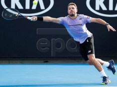 Stan Wawrinka of Switzerland in action during his men's singles first round match against Ernests Gulbis of Latvia at the Australian Open Grand Slam tennis tournament in Melbourne, Australia, 15 January 2019.  EPA-EFE/RITCHIE TONGO