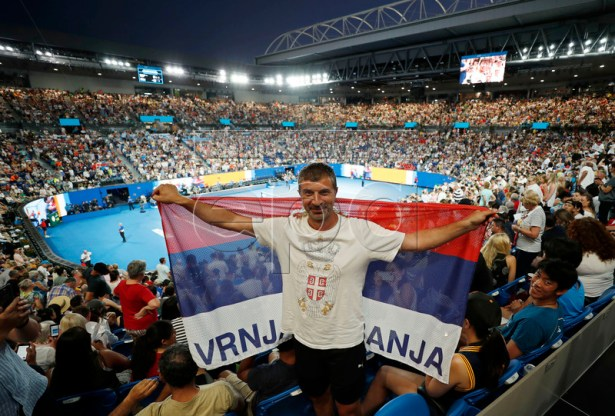 A fan of Novak Djokovic holds a Serbian flag during the men's singles first round match between Djokovic and Mitchell Krueger of the USA at the Australian Open Grand Slam tennis tournament in Melbourne, Australia, 15 January 2019.  EPA-EFE/RITCHIE TONGO