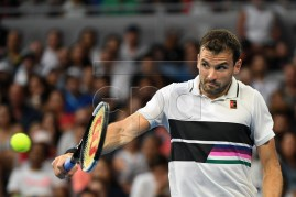 Grigor Dimitrov of Bulgaria in action against Thomas Fabbiano of Italy during day five at the Australian Open Grand Slam tennis tournament in Melbourne, Australia, 18 January 2019.  EPA-EFE/JULIAN SMITH AUSTRALIA AND NEW ZEALAND OUT