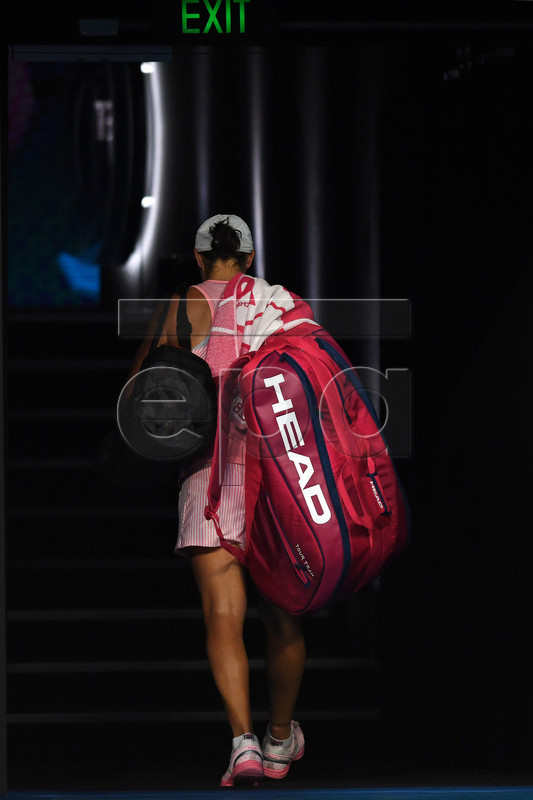 Ashleigh Barty of Australia leaves the court after losing to Petra Kvitova of the Czech Republic in their women's singles quarter final match of the Australian Open Grand Slam tennis tournament in Melbourne, Australia, 22 January 2019.  EPA-EFE/LUKAS COCH AUSTRALIA AND NEW ZEALAND OUT
