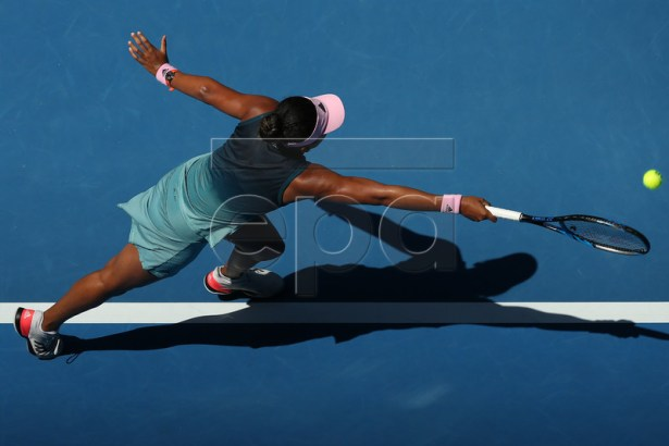 Naomi Osaka of Japan in action against Elina Svitolina of Ukraine during their women's singles quarter final match on day 10 of the Australian Open Grand Slam tennis tournament in Melbourne, Australia, 23 January 2019. EPA-EFE/HAMISH BLAIR EDITORIAL USE ONLY AUSTRALIA AND NEW ZEALAND OUT