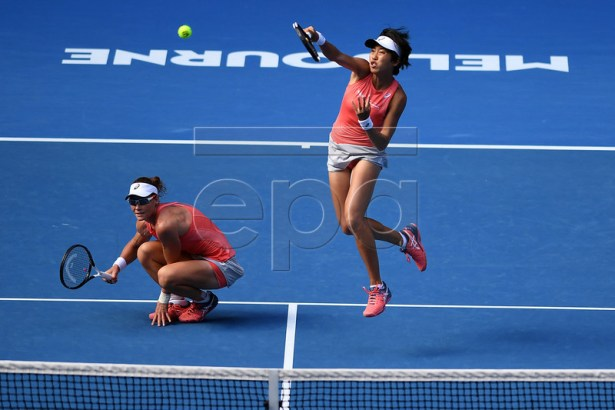 Samantha Stosur of Australia (L) and Shuai Zhang of China (R) in action against Timea Babos of Hungary and Kristina Mladenovic of France during their women's doubles final match at the Australian Open Grand Slam tennis tournament in Melbourne, Australia, 25 January 2019.  EPA-EFE/LUKAS COCH AUSTRALIA AND NEW ZEALAND OUT