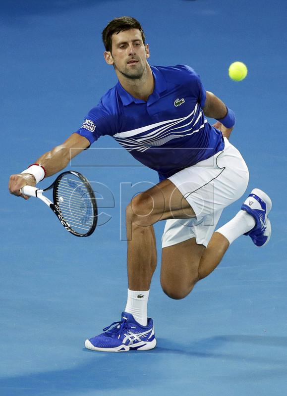 Novak Djokovic of Serbia in action during his men's singles semi final match against Lucas Pouille of France at the Australian Open Grand Slam tennis tournament in Melbourne, Australia, 25 January 2019.  EPA-EFE/LYNN BO BO