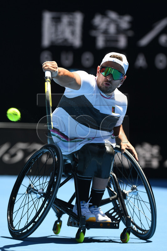 Dylan Alcott of Australia in action against David Wagner of the United States during the quad wheelchair singles final on day 13 of the Australian Open Grand Slam tennis tournament in Melbourne, Australia, 26 January 2019.  EPA-EFE/LUKAS COCH EDITORIAL USE ONLY AUSTRALIA AND NEW ZEALAND OUT
