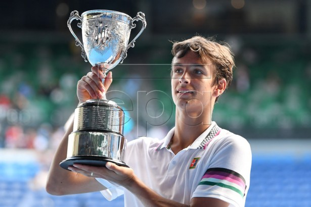 Lorenzo Musetti of Italy poses for a photograph with the winner's trophy after defeating Emilio Nava of the USA in the junior boy's singles final at the Australian Open Grand Slam tennis tournament in Melbourne, Australia, 26 January 2019.  EPA-EFE/LUKAS COCH  AUSTRALIA AND NEW ZEALAND OUT