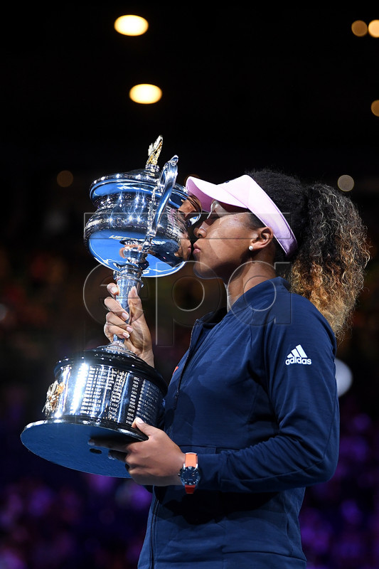 Naomi Osaka of Japan reacts during the presentation of the winner's trophy after defeating Petra Kvitova of the Czech Republic in the women's singles final at the Australian Open Grand Slam tennis tournament in Melbourne, Australia, 26 January 2019.  EPA-EFE/LUKAS COCH EDITORIAL USE ONLY AUSTRALIA AND NEW ZEALAND OUT
