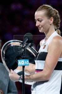 Petra Kvitova of Czech Republic receives her runners up trophy after being defeated in her women's singles final match against Naomi Osaka of Japan at the Australian Open Grand Slam tennis tournament in Melbourne, Australia, 26 January 2019.  EPA-EFE/RITCHIE TONGO