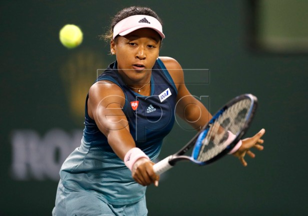 Naomi Osaka of Japan in action against Kristina Mladenovic of France during the BNP Paribas Open tennis tournament at the Indian Wells Tennis Garden in Indian Wells, California, USA, 09 March 2019. The men's and women's final will be played on 17 March 2019.  EPA-EFE/JOHN G. MABANGLO