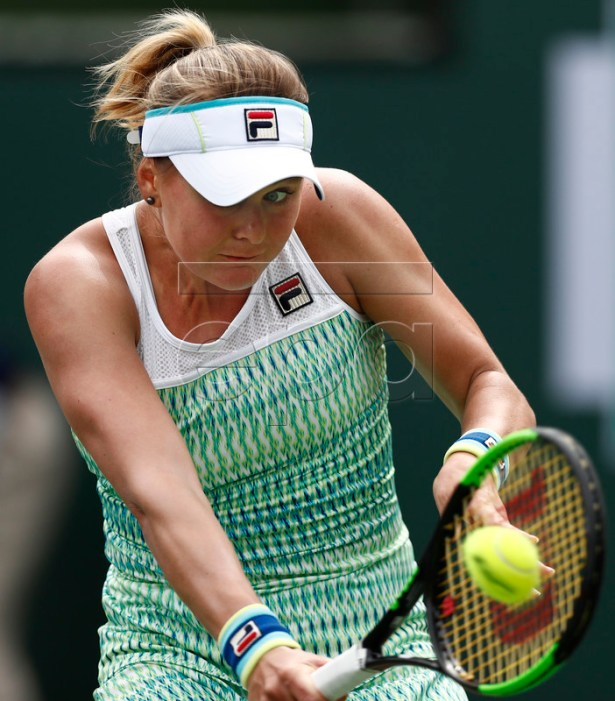 Kateryna Kozlova of Ukraine in action against Simona Halep of Romania during the BNP Paribas Open tennis tournament at the Indian Wells Tennis Garden in Indian Wells, California, USA, 10 March 2019. The men's and women's final will be played, 17 March 2019.  EPA-EFE/LARRY W. SMITH