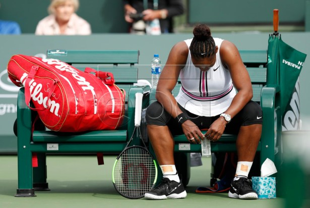 Serena Williams of the US waits for a trainer before retiring her match against Garbine Muguruza of Spain during the BNP Paribas Open tennis tournament at the Indian Wells Tennis Garden in Indian Wells, California, USA, 10 March 2019. The men's and women's final will be played, 17 March 2019.  EPA-EFE/JOHN G. MABANGLO