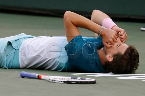 Dominic Thiem of Austria reacts after defeating Roger Federer of Switzerland during the BNP Paribas Open tennis tournament at the Indian Wells Tennis Garden in Indian Wells, California, USA, 17 March 2019.  EPA-EFE/JOHN G. MABANGLO