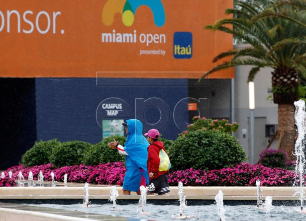 People walk on the grounds during a rain delay at the Miami Open tournament in Miami, Florida, USA, 19 March 2019.  EPA-EFE/JASON SZENES