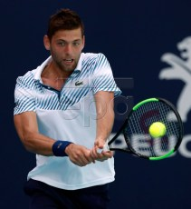 Filip Krajinovic of Serbia in action against Stan Wawrinka of Switzerland during their match at the Miami Open tennis tournament in Miami, Florida, USA, 23 March 2019.  EPA-EFE/JASON SZENES