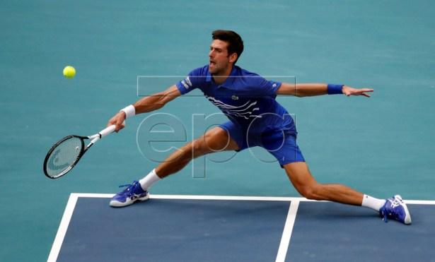 Novak Djokovic of Serbia in action against Roberto Bautista Agut of Spain during their men's singles match at the Miami Open tennis tournament in Miami, Florida, USA, 26 March 2019.  EPA-EFE/JASON SZENES