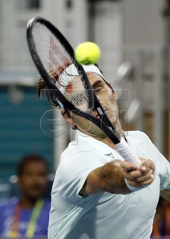 Roger Federer of Switzerland in action against Denis Shapovalov of Canada during their semifinal match at the Miami Open tennis tournament in Miami, Florida, USA, 29 March 2019.  EPA-EFE/RHONA WISE