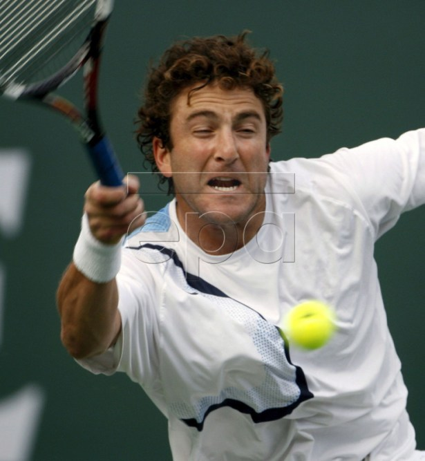 American Justin Gimelstob returns a shot against Lucasz Kubot during men's qualifying at the Pacific Life Open tennis tournament in Indian Wells, California, Thursday, 09 March 2006. EPA/PAUL BUCK