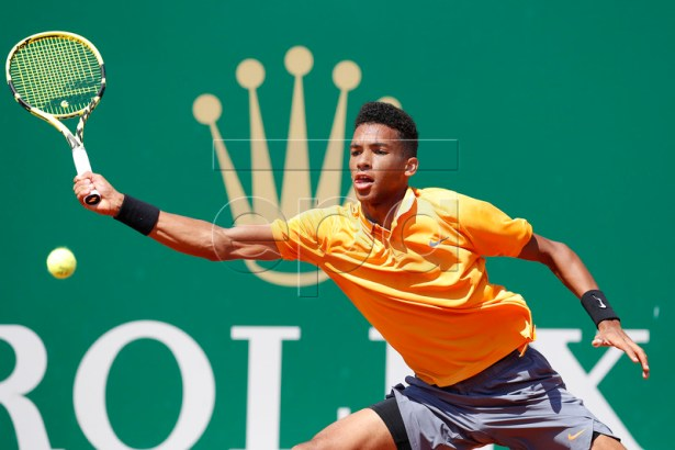 Felix Auger-Aliassime of Canada in action during his second round match against Alexander Zverev of Germany at the Monte-Carlo Rolex Masters tournament in Roquebrune Cap Martin, France, 17 April 2019. EPA-EFE/SEBASTIEN NOGIER