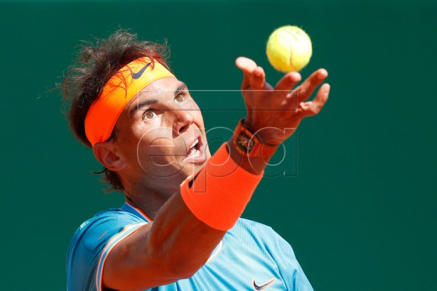 Rafael Nadal of Spain in action during his secound round match against Roberto Bautista Agut of Spain at the Monte-Carlo Rolex Masters tournament in Roquebrune Cap Martin, France, 17 April 2019.  EPA-EFE/SEBASTIEN NOGIER
