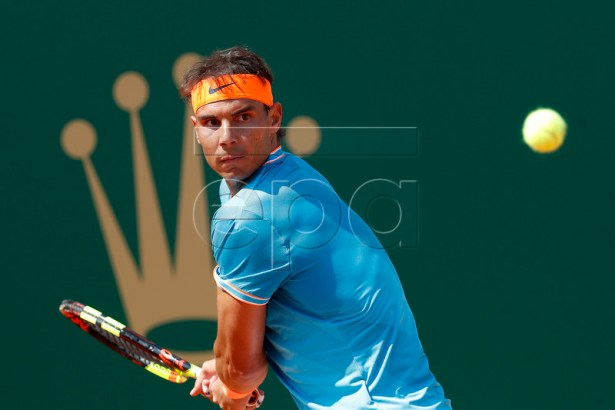 Rafael Nadal of Spain in action during his third round match against Grigor Dimitrov of Bulgaria at the Monte-Carlo Rolex Masters tournament in Roquebrune Cap Martin, France, 18 April 2018.  EPA-EFE/SEBASTIEN NOGIER